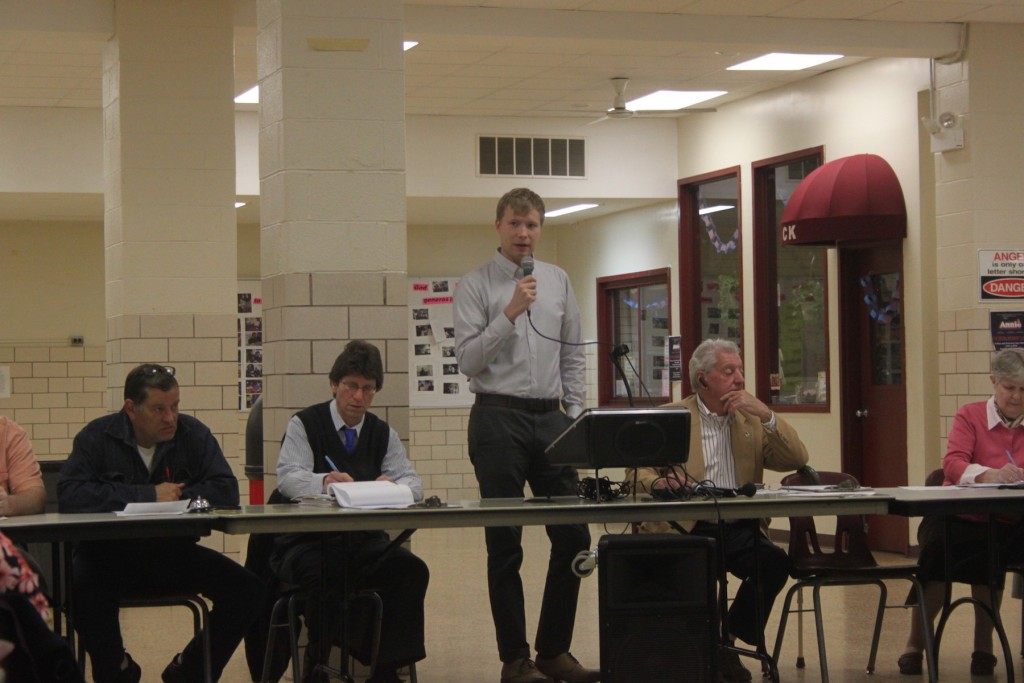 Jeremiah Hay of Pre-K For All speaks at the Community Board 5 Meeting at Christ the King High School.