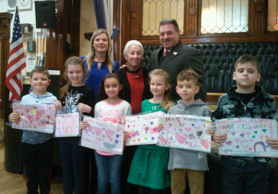Students from PS 88 show off the valentines they created for veterans.